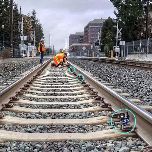 Installing rail clip prisms